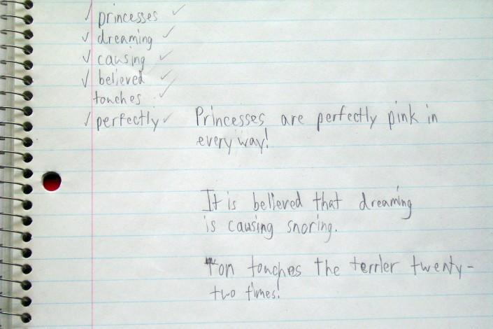 Notebook with child's handwritten sentences