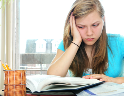 dyslexia - teenage girl studying with textbooks