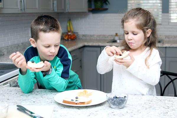 Children enjoying tasty ABC snack