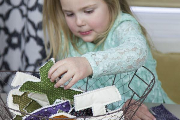 Preschooler playing with fabric alphabet