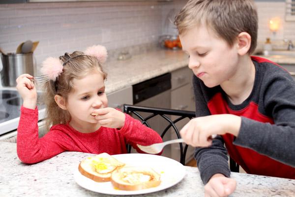 Preschoolers enjoying egg snack