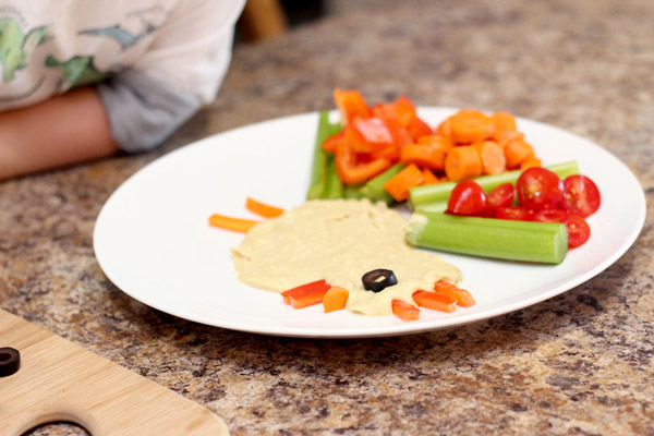 Completed snack of hummus and vegetables
