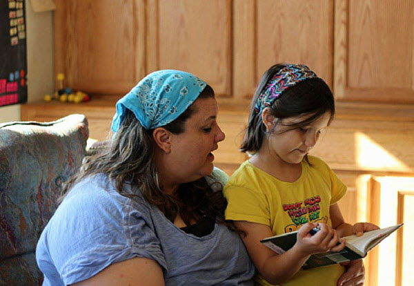 mom buddy reading with young girl