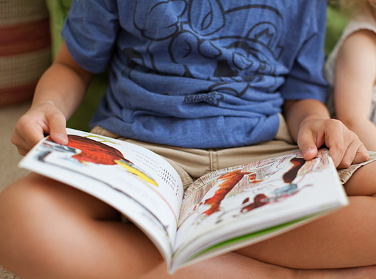 Closeup of child reading a book