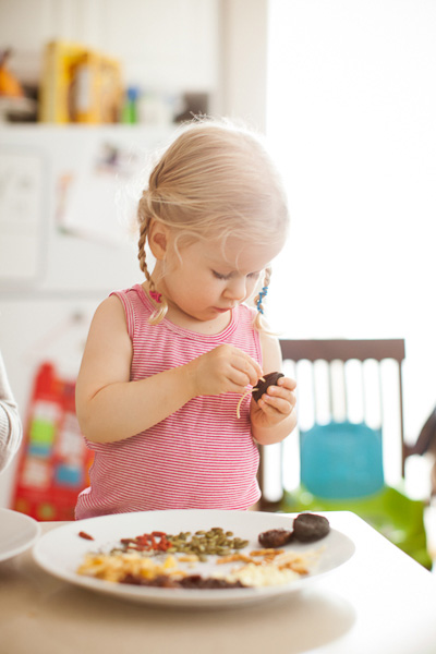 Preschooler assembling snack