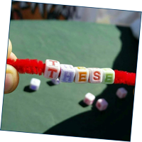 Letter beads threaded on pipe cleaner