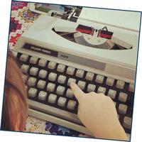 Child using typewriter