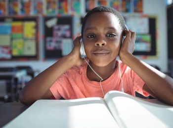 boy listening to a book on tape