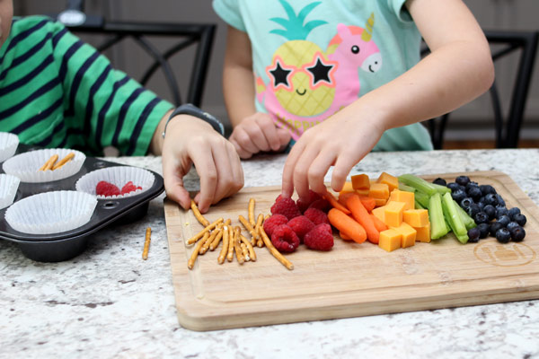 Children sorting through fruit and veggies