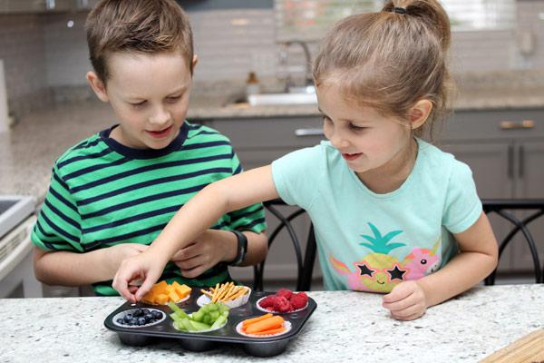 Children assembling ABC snack