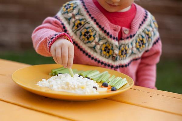 Preschooler eating snack
