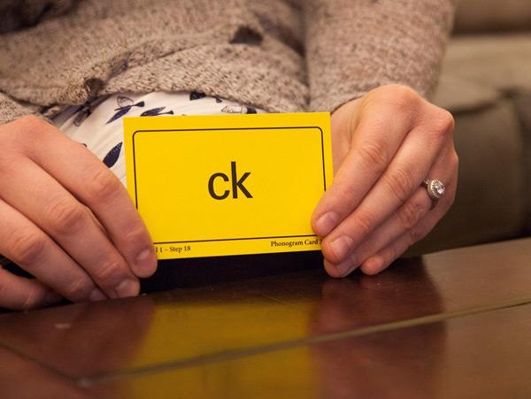 Woman holding Phonogram Card 'ck'