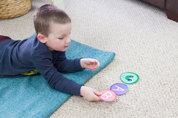Preschooler building ABC caterpillar