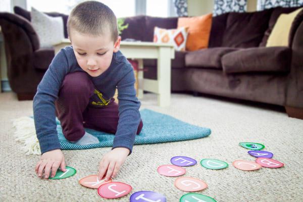 Young boy building ABC caterpillar