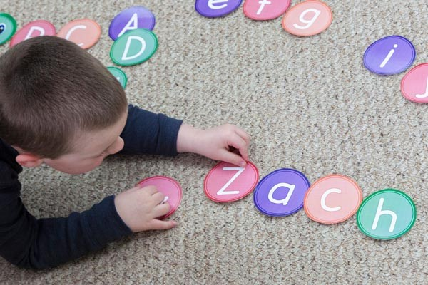 Young boy spelling name