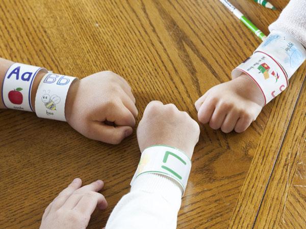 Children with ABC bracelets on