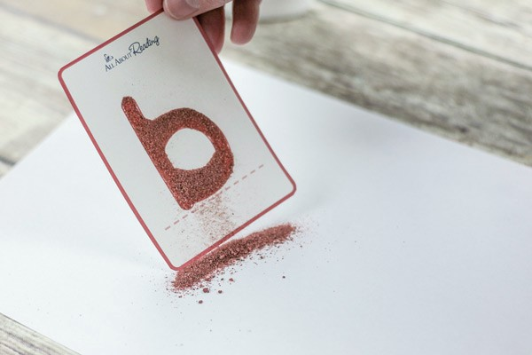 Using colored sand on tactile letter card