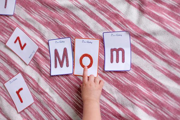 Preschooler spelling 'mom'