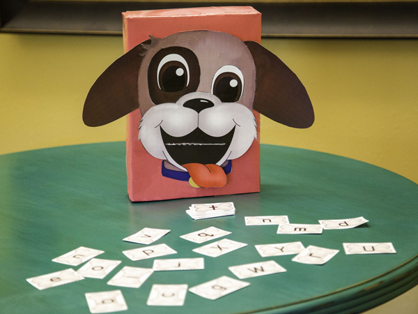 Feed the Puppy Alphabet Game on table