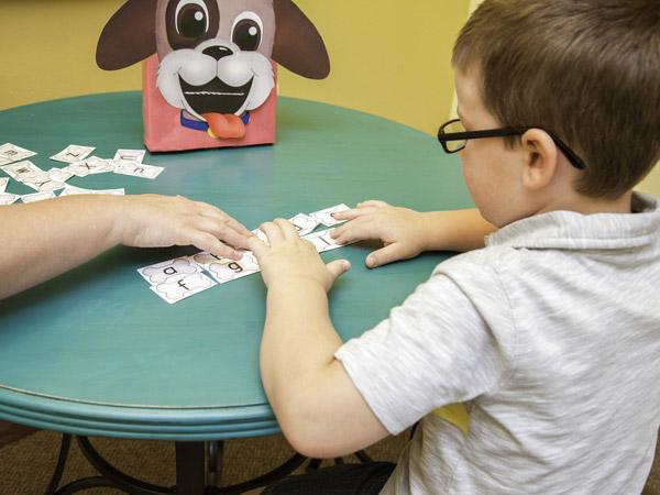 Preschooler playing alphabet game