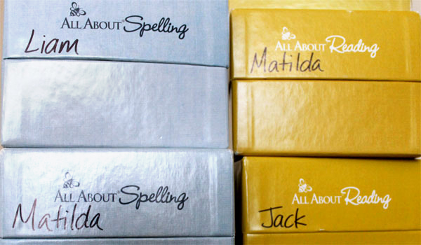 All About Reading and All About Spelling review boxes for several children