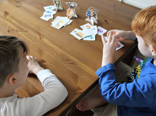 Two boys playing a reading game together