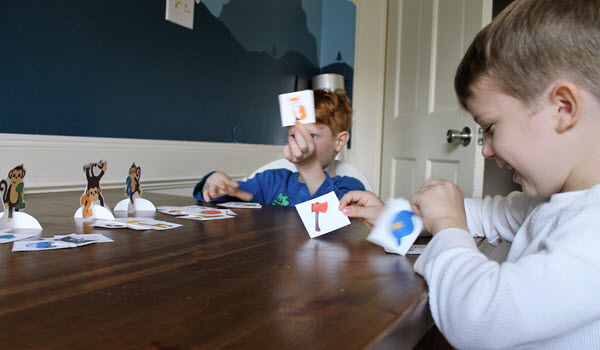 2 children playing a reading game together.