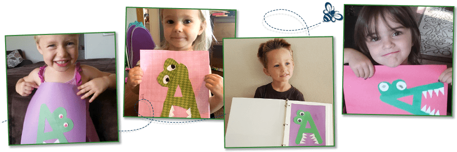 children holding their finished A Is for Alligator Craft
