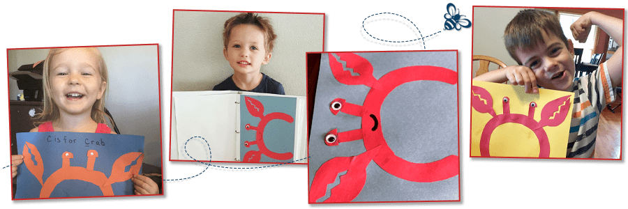 children holding their finished C Is for Crab Craft