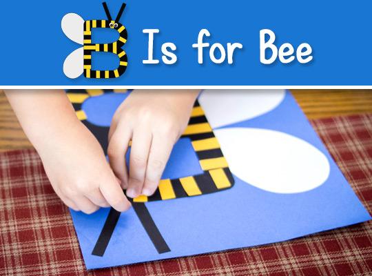 child assembling bee craft