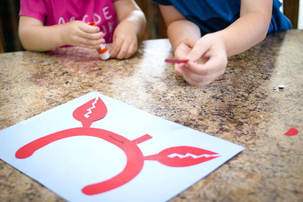 children assembling letter c craft