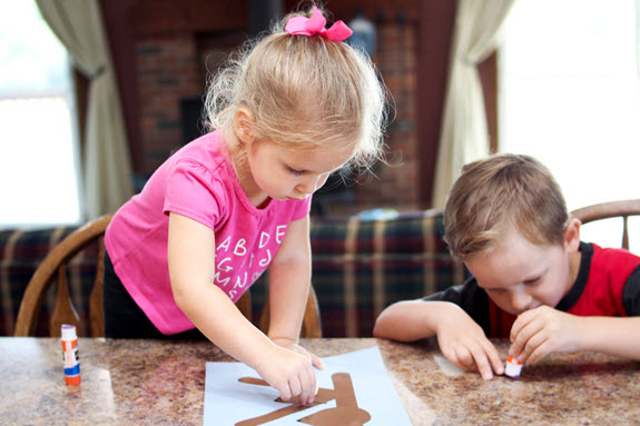 two children working on their letter k craft