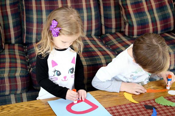 children assembling their letter P craft