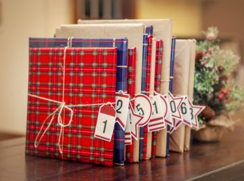 wrapped books with advent calendar tags
