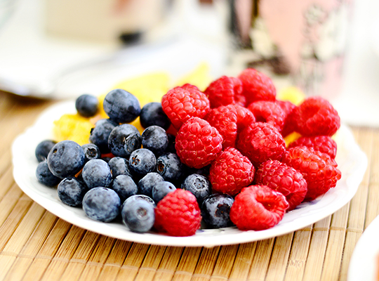 plateful of blueberries and raspberries