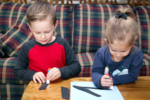 children gluing letter v craft