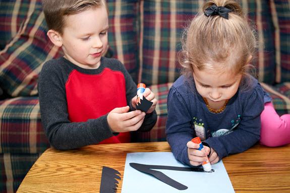 children putting together letter v craft