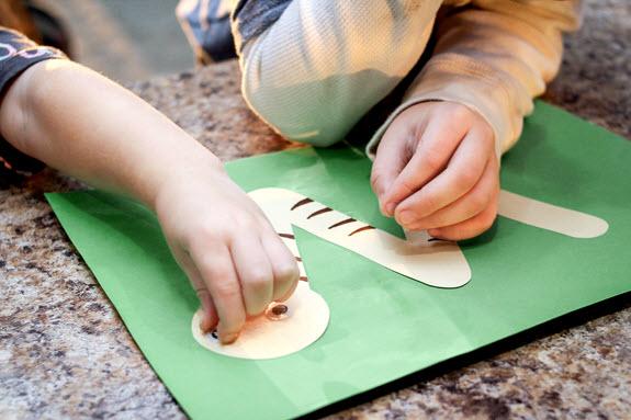 children gluing letter w craft