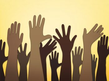 shades of brown hands reaching up