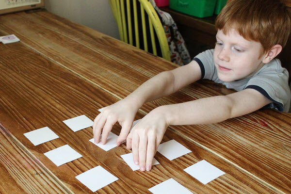 boy selects rhyming activity cards