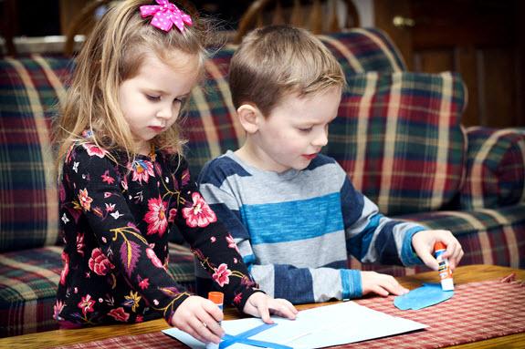 children working on their letter x craft