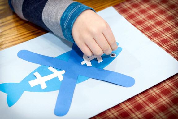 boy assembles his letter x craft