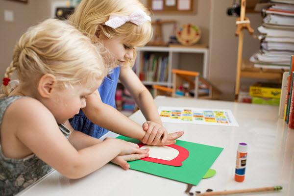 girls assembling lowercase a craft