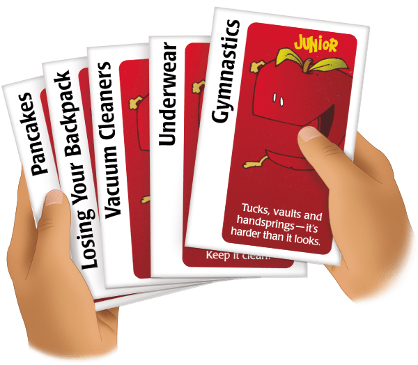 child holding apples to apples cards