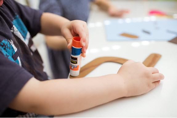 child glues lowercase h craft