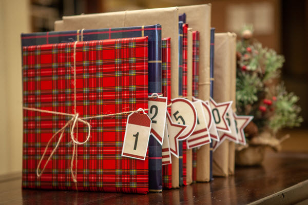 wrapped books with book advent calendar tags