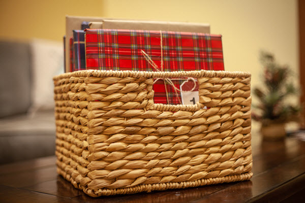 wrapped books in a basket for book advent calendar