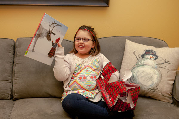 girl opens a picture book for book advent calendar