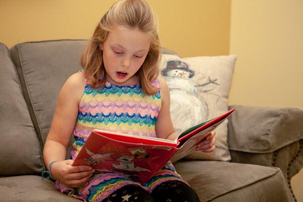 girl reads her advent calendar book