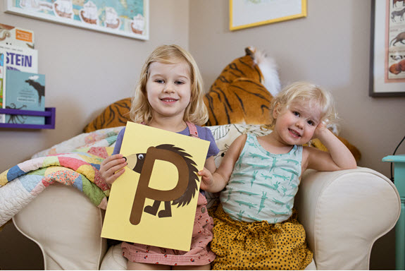 sisters smile with their uppercase letter P craft